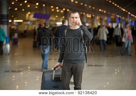 Young Traveler In Airport Making Call