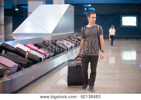 Young Man At Conveyor Belt