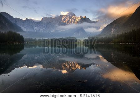 beautiful sunrise over the mountain lake in the Julian Alps
