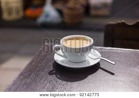 Cup Of Coffee On Table Outside