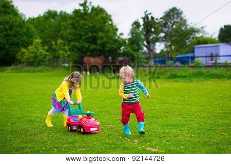 Kids Playing On A Farm