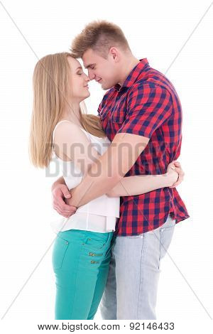 First Love Concept - Young Man And Woman Kissing Isolated On White