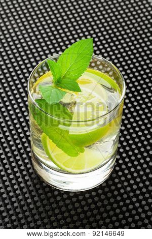 Mojito cocktail on black rubber bar mat