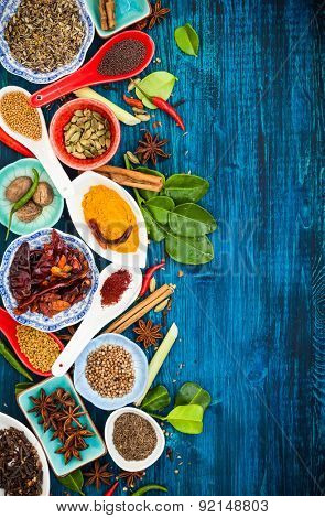 Various asian spices and herbs on a blue wooden background.Top view