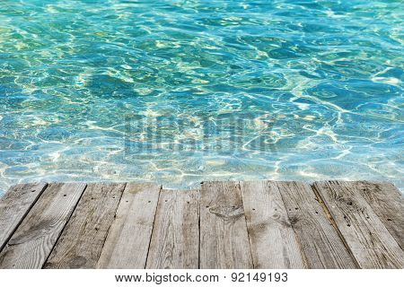 Empty Wooden Table To Tropical Blue Water Background