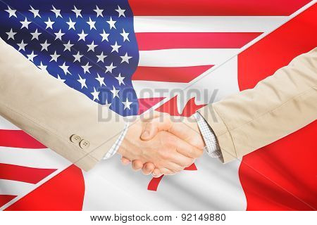 Businessmen Handshake - United States And Canada