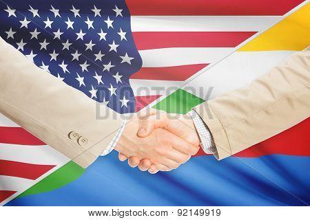 Businessmen Handshake - United States And Comoros
