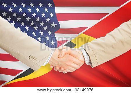 Businessmen Handshake - United States And East Timor
