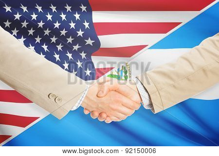 Businessmen Handshake - United States And El Salvador