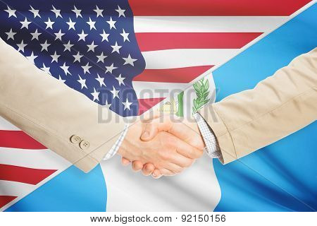 Businessmen Handshake - United States And Guatemala