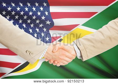 Businessmen Handshake - United States And Guyana