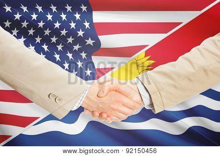 Businessmen Handshake - United States And Kiribati