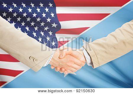 Businessmen Handshake - United States And Micronesia