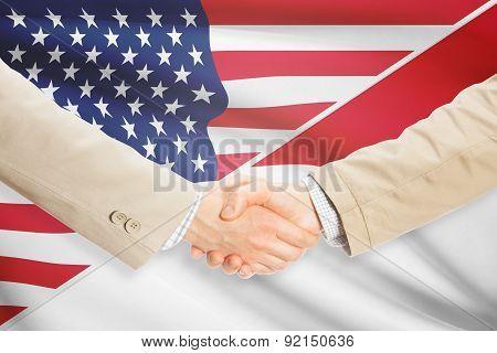 Businessmen Handshake - United States And Monaco