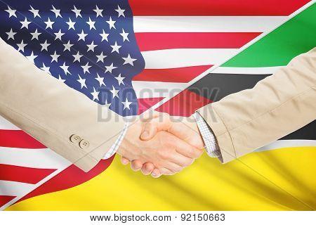 Businessmen Handshake - United States And Mozambique