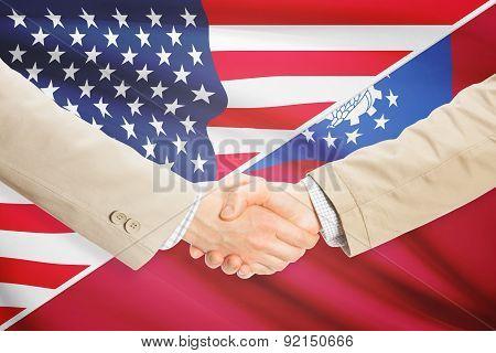 Businessmen Handshake - United States And Bhutan