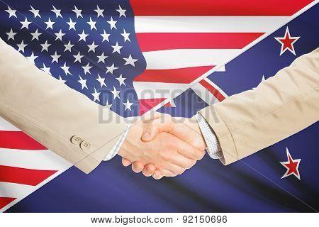Businessmen Handshake - United States And New Zealand