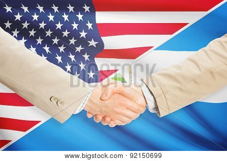 Businessmen Handshake - United States And Nicaragua