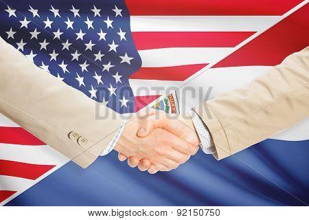 Businessmen Handshake - United States And Paraguay