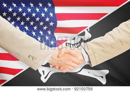 Businessmen Handshake - United States And Jolly Roger