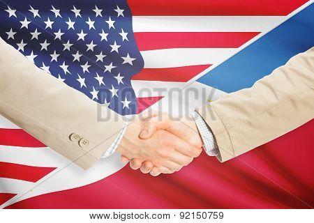 Businessmen Handshake - United States And Philippines