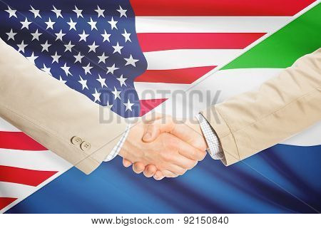 Businessmen Handshake - United States And Sierra Leone