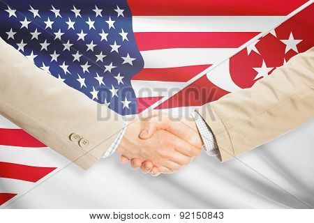 Businessmen Handshake - United States And Singapore