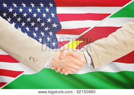 Businessmen Handshake - United States And Suriname
