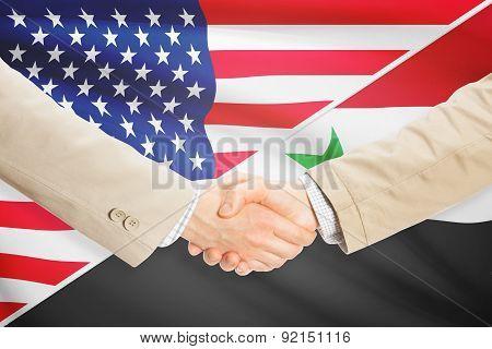 Businessmen Handshake - United States And Syria
