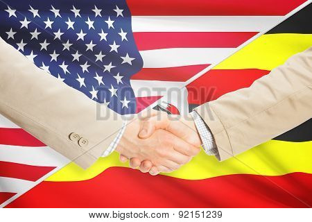 Businessmen Handshake - United States And Uganda
