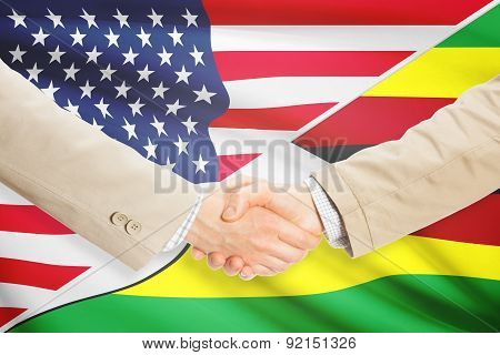Businessmen Handshake - United States And Zimbabwe