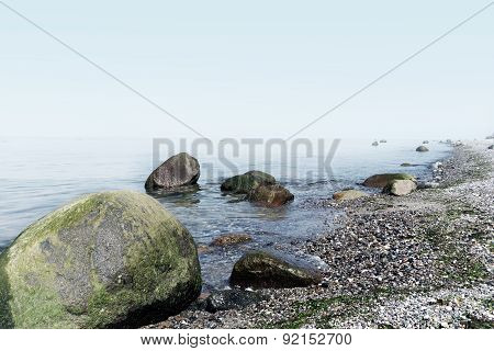 Large Stones On The Sea Beach, Background Foggy