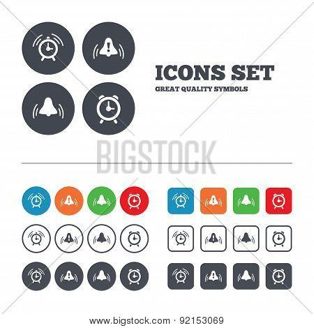 Alarm clock icons. Wake up bell signs symbols.
