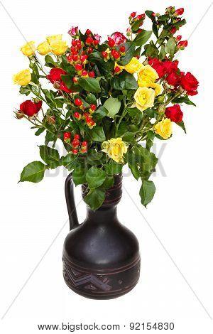 Roses And Hypericum Flowers In Ceramic Vase