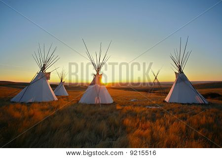 Tipis At Sunrise On The Prairie