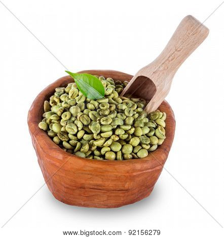 green coffee beans in wooden bowl, close-up.