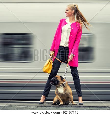Beautiful Modern Girl With A Dog On The Platform