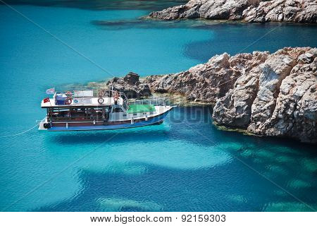 Little Boat On The Turquoise Sea