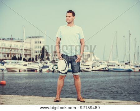 Handsome Fashion Man On Pier In Port With Yachts.