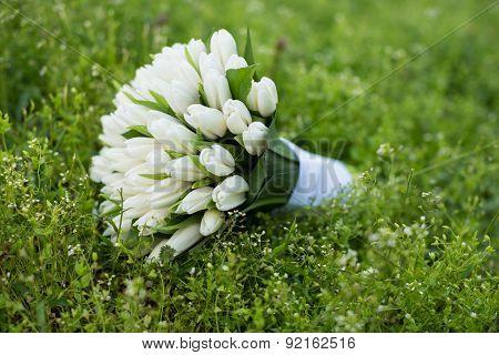 Close-up of wedding bouquet on grass