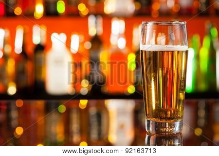 Vapid jug of beer placed on bar counter with copy space