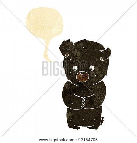 cute cartoon black bear with speech bubble