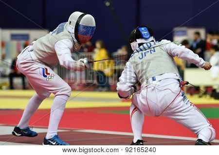 ST. PETERSBURG, RUSSIA - MAY 3, 2015: Alexey Cheremisinov of Russia vs Kenta Chida of Japan in team quarterfinal of International fencing tournament St. Petersburg Foil, the stage of FIE World Cup