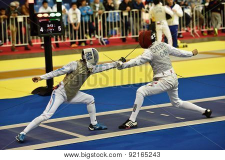 ST. PETERSBURG, RUSSIA - MAY 2, 2015: Erwan Le Pechoux of France vs Haiwei Chen of China in 1/8 final of International fencing tournament St. Petersburg Foil. The tournament is the stage of World Cup