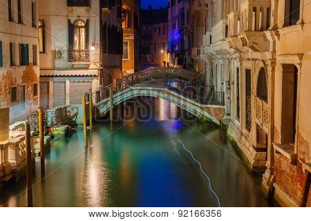 Night lateral canal and bridge in Venice, Italy