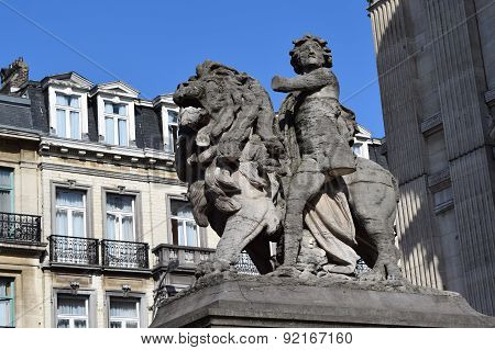 Statue in Brussels, Belgium with Lion and boy with one leg and one arm