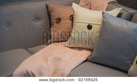 Pillows on a grey modern corner sofa
