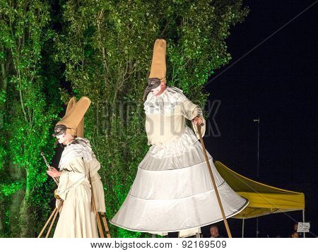 People On Stilts Perform Romeo And Juliet  Wearing Carnival Costumes