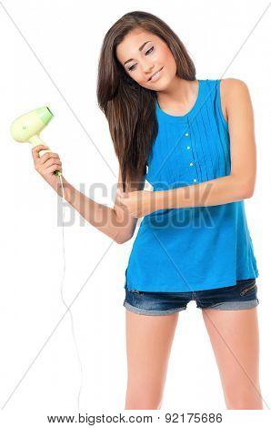 Girl with hair dryer, isolated on white background