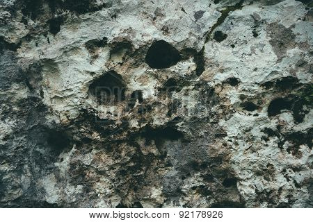 Abstract Silhouette Of Skull On The Stone Wall
